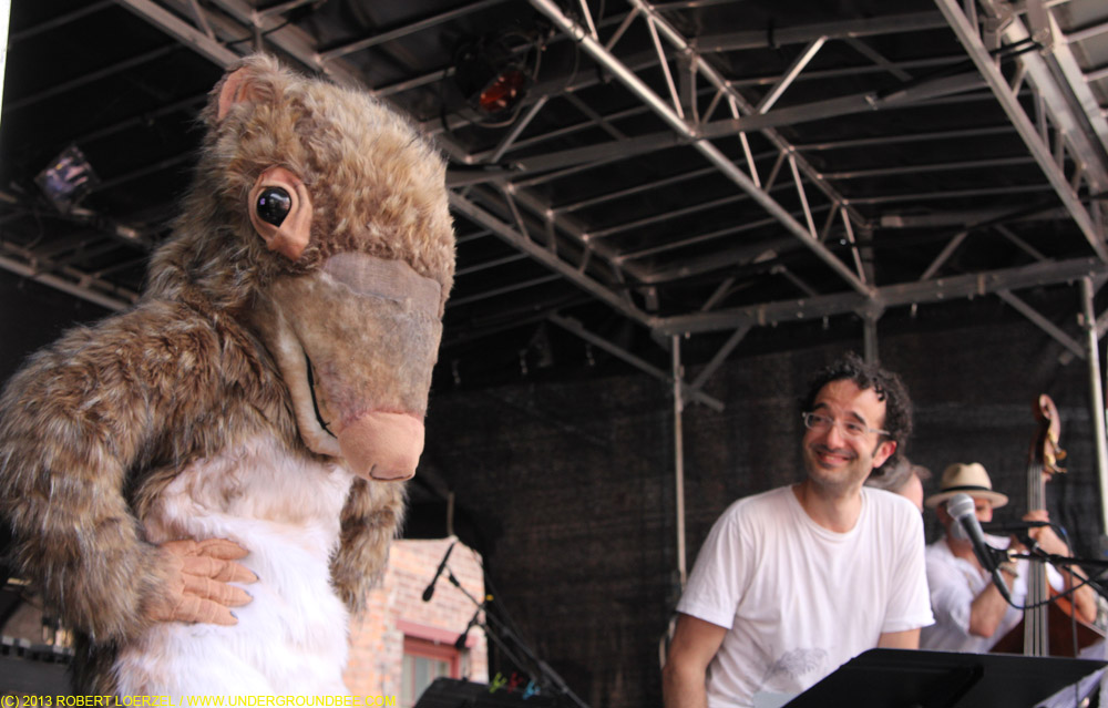 "The key mammal that survived the meteor explosion that killed off the dinosaurs — the shrewdinger — appears during ""Radio Lab,"" with Jad Abumrad, right."