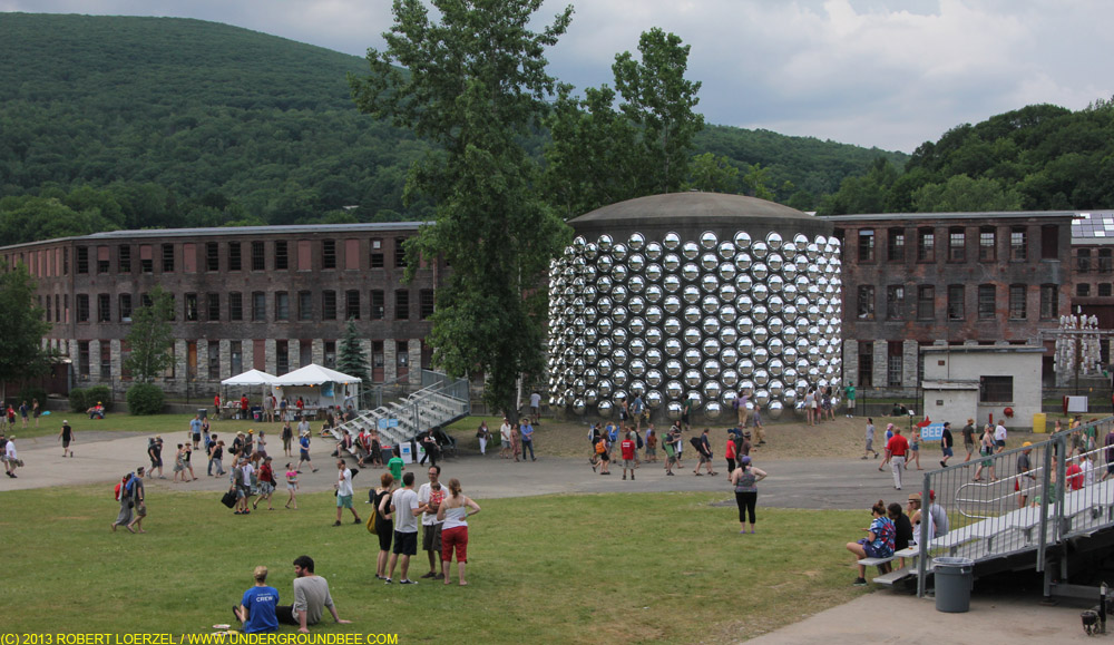 "Artist Marko Remec's installation ""Can't Hear You (Fat Totem)"" — acrylic dome safety mirrors strung up on an old water tank — on the Solid Sound festival grounds at MASS MoCA"