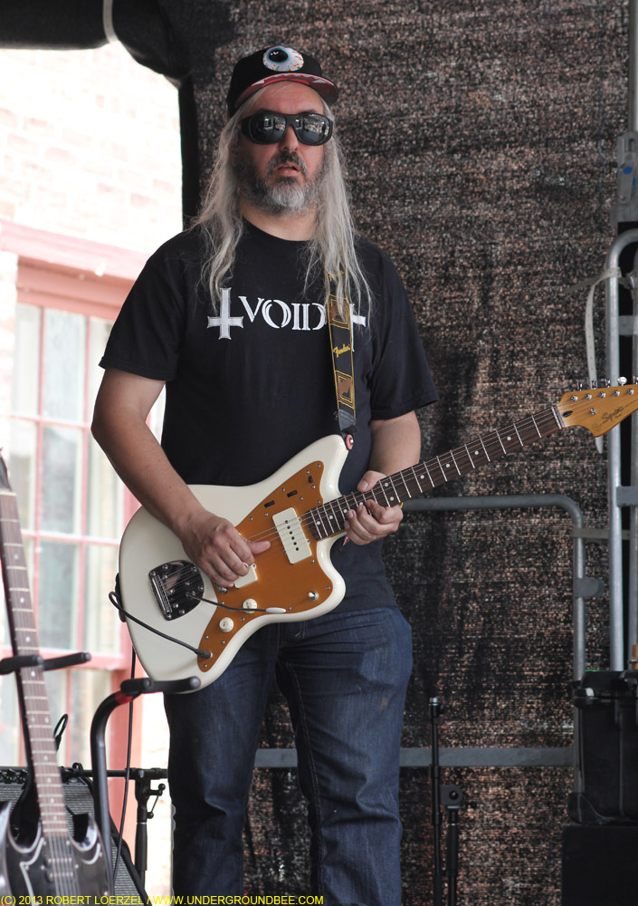 J. Mascis plays guitar during Mark Mulchay's set